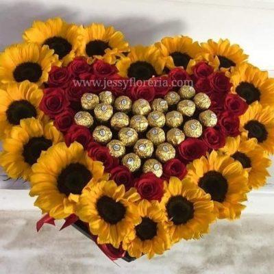 Corazón de girasoles rosas y Ferreros