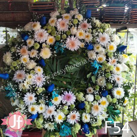 Corona surtida de rosas azules